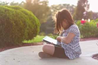 girl using ipad outdoors