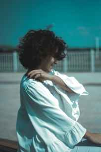 woman holding white dress